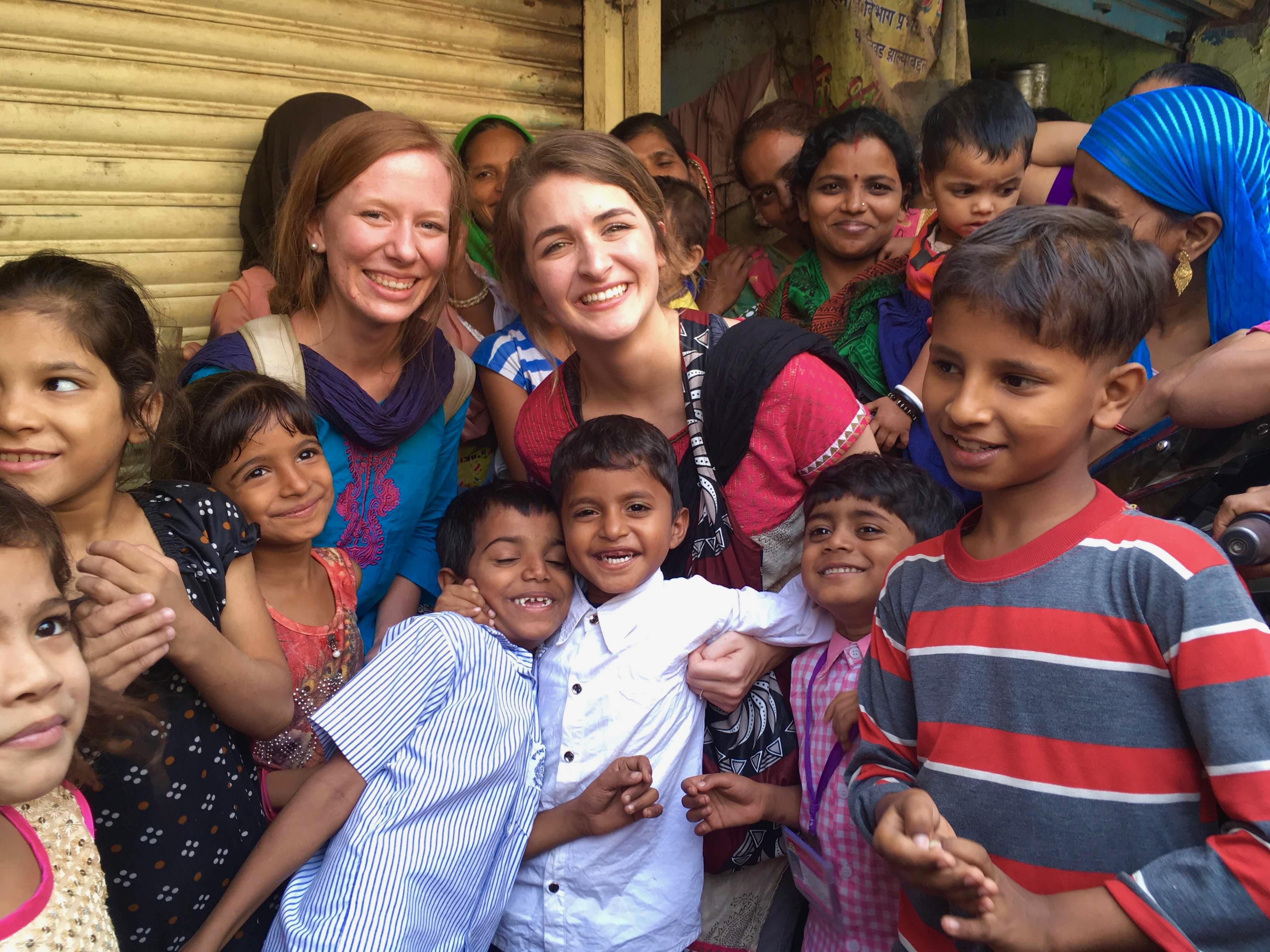 TMU students with children on a mission trip